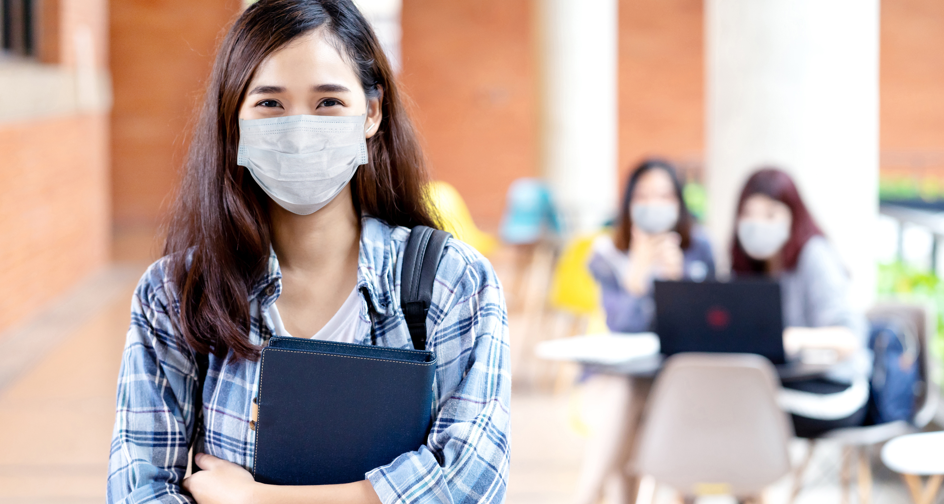 College student wearing a mask during COVID-19